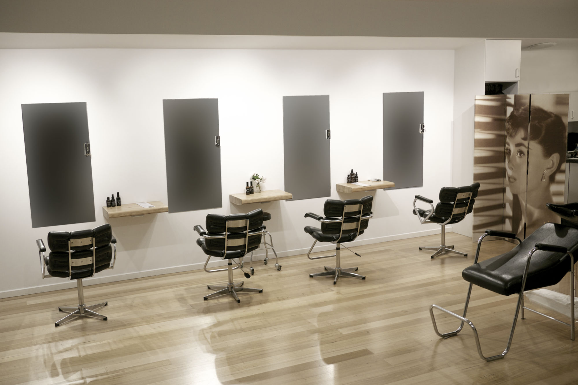Chairs and mirrors at Tangles Hair Design San Remo
